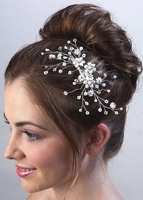 Bijou de cheveux - Multicolore - Ce magnifique bijou de cheveux est une pince à cheveux représentant une jolie fleur ornée de cristaux strass et de cristal .